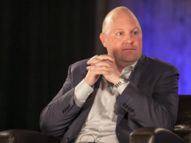 Marc Andreessen sitting in a black armchair