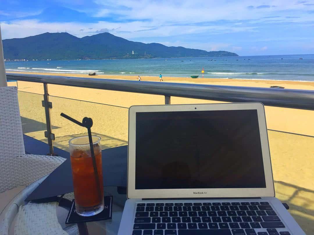 Laptop and drink near a beach in Da Nang, Vietnam