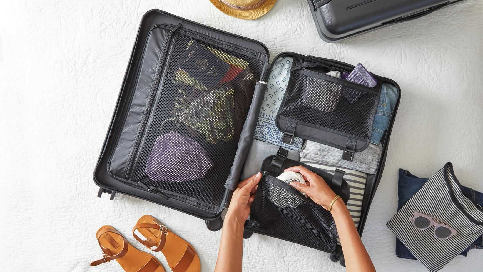 Woman packing up in a suitcase