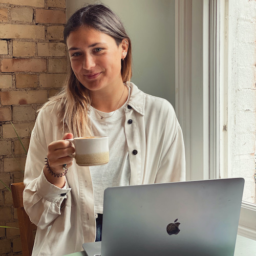 Lucy Johnson with her computer and coffe