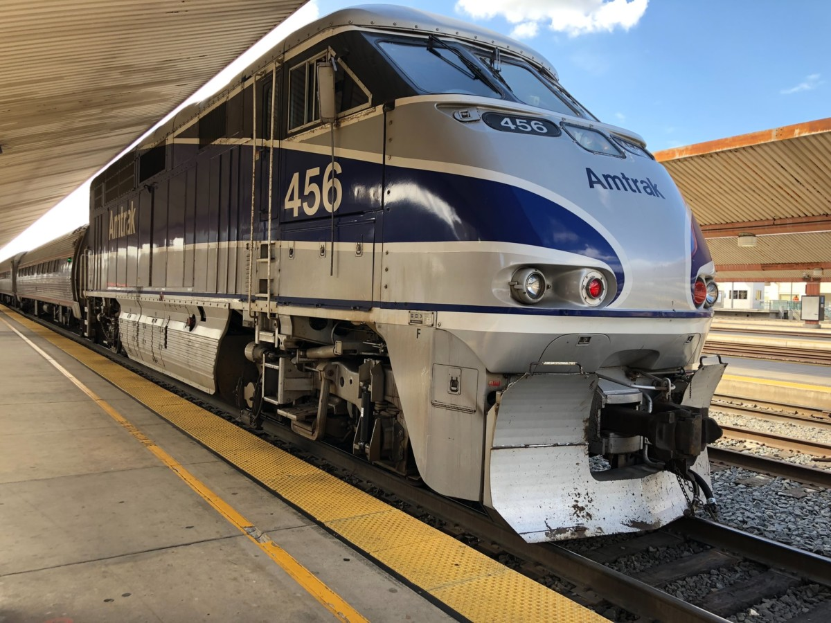 An Amtrak train stopped at a station