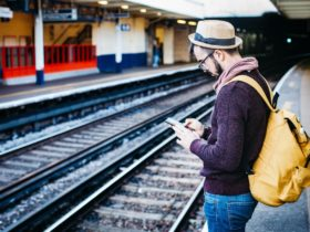 Person using phone while waiting for train