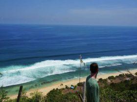 Cameron looking to the beach in Jimbaran, Bali, Indonesia