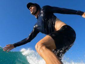 Cameron surfing during a sunny day in San José del Cabo, in Baja California, Mexico