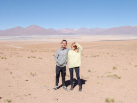 Tom and Laura huging each other in the desert