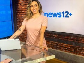 Michelle Marie smiling in news12+ while wearing a pink dress