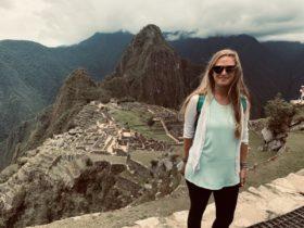 Anny Wooldridge standing in front of a part of Machu Picchu in Peru