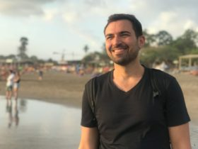 Michael Alexis smiling on a beach in Bali