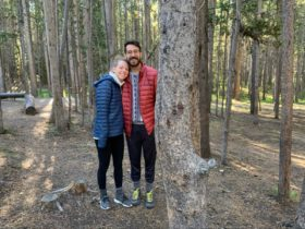 Becca and Brandon together in the woods while wearing warm clothing