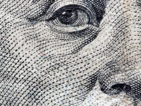 Close up of Benjamin Franklin's face on the 100 dollars bill
